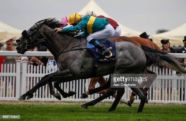 Olivier Peslier riding Coronet win The Ribblesdale Stakes from Mori and Hertford Dancer on day 3 'Ladies Day' of Royal Ascot at Ascot Racecourse on...