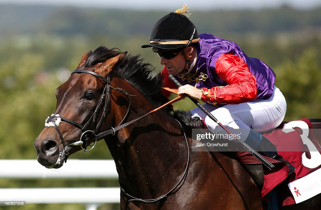Olivier Peslier riding Dartmouth win The Educate A Child Stakes at Goodwood racecourse on August 01 2015 in Chichester England