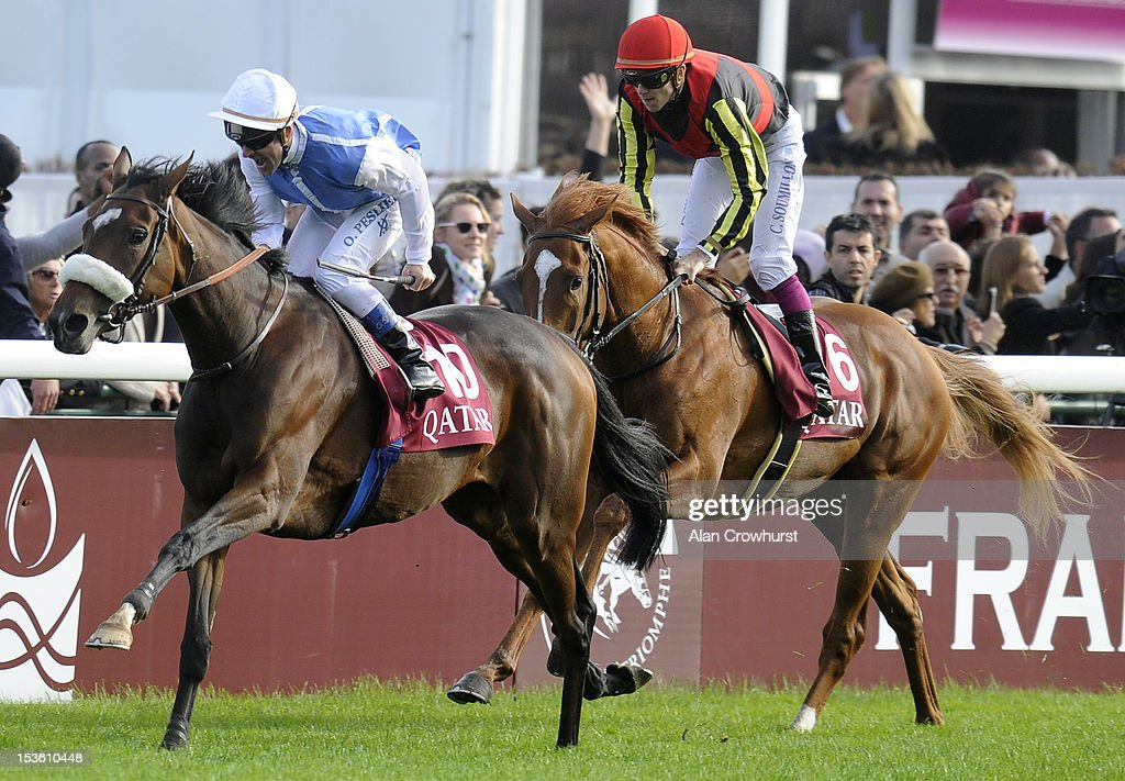 <a gi-track='captionPersonalityLinkClicked' href=/galleries/search?phrase=Olivier+Peslier&family=editorial&specificpeople=220682 ng-click='$event.stopPropagation()'>Olivier Peslier</a> riding Solemia (L) catch Orfevre and Christophe Soumillon (R) to win the Qatar Prix de L'Arc de Triomphe at Longchamp racecourse on October 07, 2012 in Paris, France.