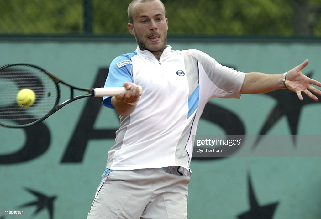 Olivier Rochus defeats Guillermo Garcia-Lopez at the 2005 French Open in Roland Garros Stadium on the May 24, 2005.