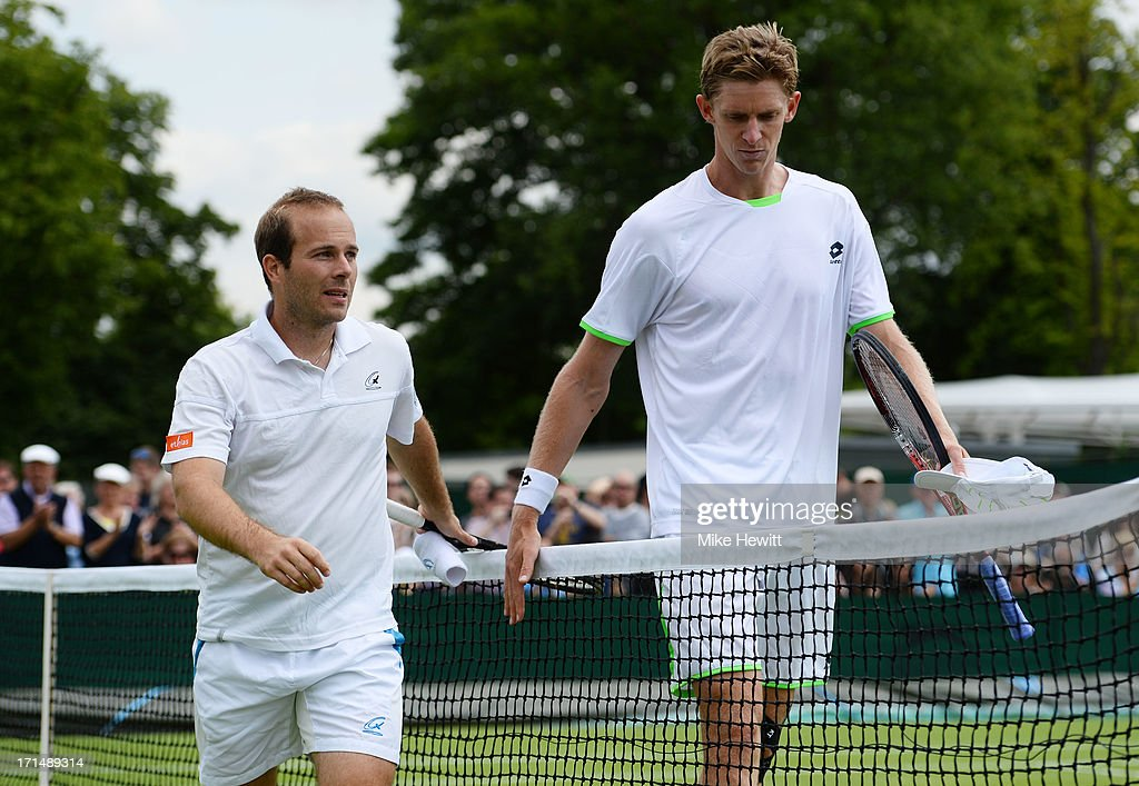 Olivier Rochus of Belgium and Kevin Anderson of South Africa walk off court after their Gentlemen's Singles first round match on day two of the Wimbledon Lawn Tennis Championships at the All England Lawn Tennis and Croquet Club on June 25, 2013 in London, England.