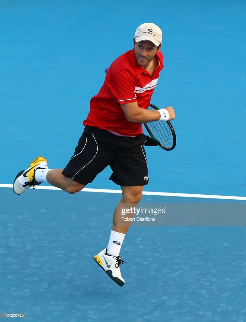 Olivier Rochus of Belgium celebrates his win over Carsten Ball of Australia during day one of the Davis Cup tie between Australia and Belgium at Cairns International Tennis Centre on September 17, 2010 in Cairns, Australia.