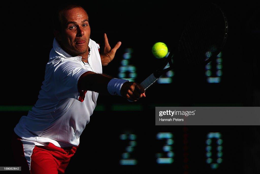 Olivier Rochus of Belgium plays a backhand during his first round match against Albert Ramos of Spain during day one of the Heineken Open at ASB Tennis Centre on January 7, 2013 in Auckland, New Zealand.
