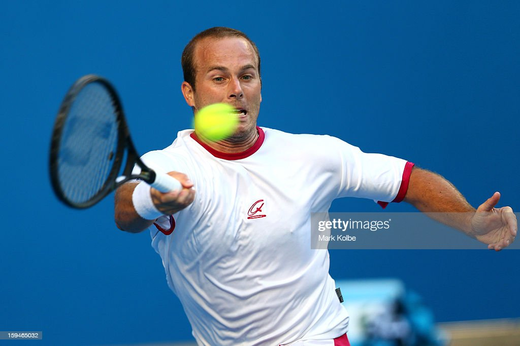 Olivier Rochus of Belgium plays a forehand in his first round match against David Ferrer of Spain during day one of the 2013 Australian Open at Melbourne Park on January 14, 2013 in Melbourne, Australia.