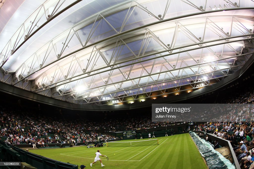 Olivier Rochus of Belgium plays a shot during his first round match against Novak Djokovic of Serbia on Day One of the Wimbledon Lawn Tennis Championships at the All England Lawn Tennis and Croquet Club on June 21, 2010 in London, England.