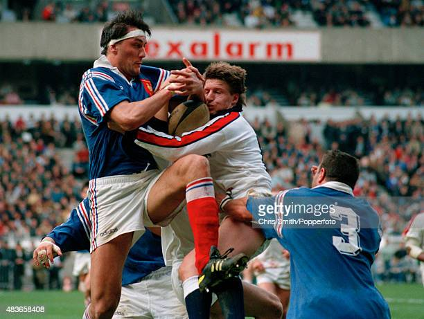Olivier Roumat of France and Micky Skinner of England in action during the Rugby Union International between France and England at the Parc des...