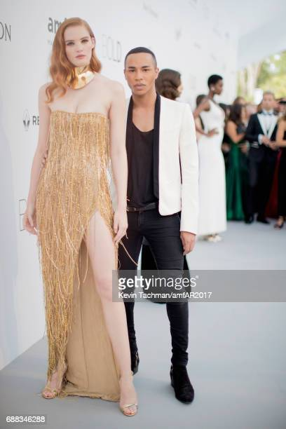 Olivier Rousteing and Alexina Graham arrive at the amfAR Gala Cannes 2017 at Hotel du CapEdenRoc on May 25 2017 in Cap d'Antibes France