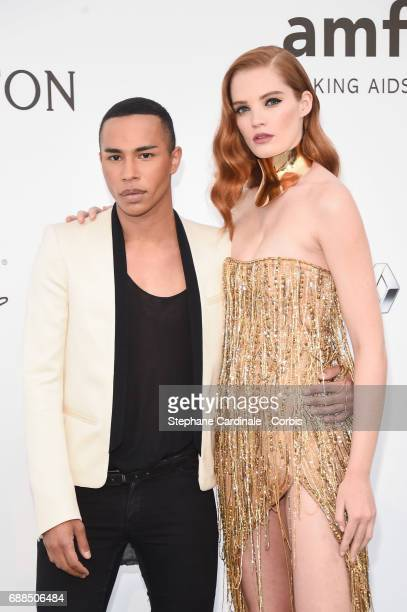 Olivier Rousteing and Alexina Graham arrives at the amfAR Gala Cannes 2017 at Hotel du CapEdenRoc on May 25 2017 in Cap d'Antibes France