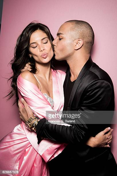Olivier Rousteing and Sara Sampaio pose backstage prior the 2016 Victoria's Secret Fashion Show on November 30 2016 in Paris France