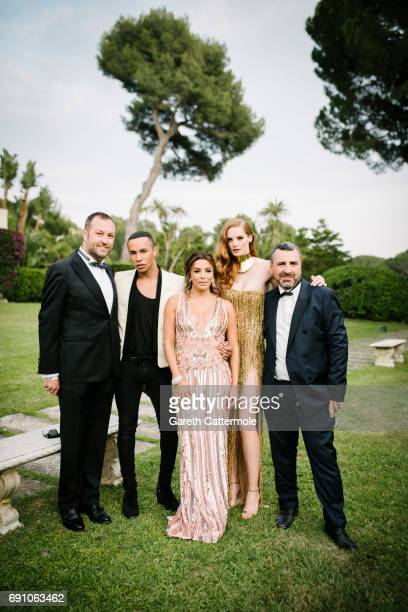 Olivier Rousteing Eva Longoria Alexina Graham Remy Averna and Doutzen Kroes attend the amfAR Gala Cannes 2017 at Hotel du CapEdenRoc on May 25 2017...
