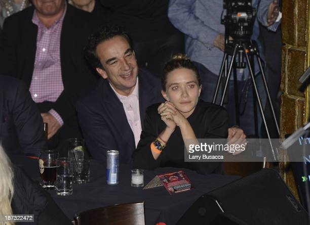 Olivier Sarkosy and Mary Kate Olsen attend performance of Ronnie Wood And Mick Taylor With Special Guests at The Cutting Room on November 7 2013 in...