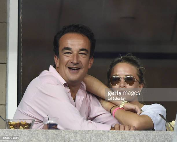Olivier Sarkozy and Mary Kate Olsen attend day 8 of the 2014 US Open at USTA Billie Jean King National Tennis Center on September 1 2014 in New York...