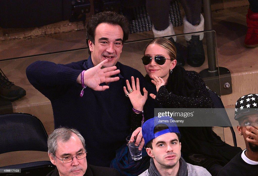 Olivier Sarkozy and Mary-Kate Olsen attend the Atlanta Hawks vs New York Knicks game at Madison Square Garden on December 14, 2013 in New York City.