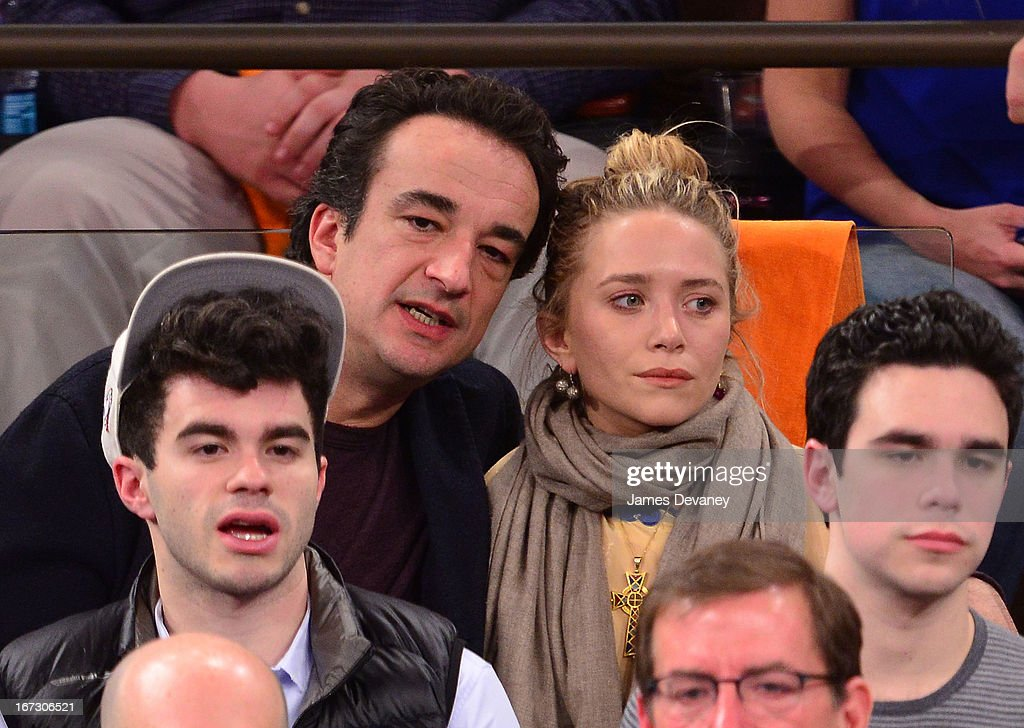 <a gi-track='captionPersonalityLinkClicked' href=/galleries/search?phrase=Olivier+Sarkozy&family=editorial&specificpeople=5577808 ng-click='$event.stopPropagation()'>Olivier Sarkozy</a> and <a gi-track='captionPersonalityLinkClicked' href=/galleries/search?phrase=Mary-Kate+Olsen&family=editorial&specificpeople=156430 ng-click='$event.stopPropagation()'>Mary-Kate Olsen</a> attend the Boston Celtics vs New York Knicks Playoff Game at Madison Square Garden on April 23, 2013 in New York City.