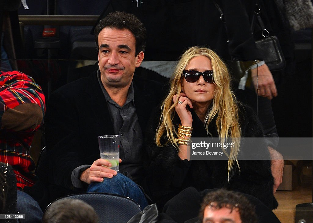 <a gi-track='captionPersonalityLinkClicked' href=/galleries/search?phrase=Olivier+Sarkozy&family=editorial&specificpeople=5577808 ng-click='$event.stopPropagation()'>Olivier Sarkozy</a> and <a gi-track='captionPersonalityLinkClicked' href=/galleries/search?phrase=Mary-Kate+Olsen&family=editorial&specificpeople=156430 ng-click='$event.stopPropagation()'>Mary-Kate Olsen</a> attend the Cleveland Cavaliers vs New York Knicks game at Madison Square Garden on December 15, 2012 in New York City.