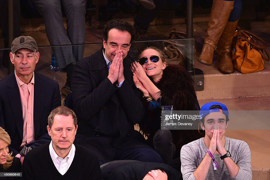 <a gi-track='captionPersonalityLinkClicked' href=/galleries/search?phrase=Olivier+Sarkozy&family=editorial&specificpeople=5577808 ng-click='$event.stopPropagation()'>Olivier Sarkozy</a> and <a gi-track='captionPersonalityLinkClicked' href=/galleries/search?phrase=Mary-Kate+Olsen&family=editorial&specificpeople=156430 ng-click='$event.stopPropagation()'>Mary-Kate Olsen</a> attend the Indiana Pacers vs New York Knicks game at Madison Square Garden on November 20, 2013 in New York City.