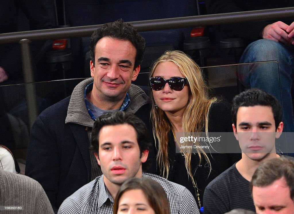 <a gi-track='captionPersonalityLinkClicked' href=/galleries/search?phrase=Olivier+Sarkozy&family=editorial&specificpeople=5577808 ng-click='$event.stopPropagation()'>Olivier Sarkozy</a> and <a gi-track='captionPersonalityLinkClicked' href=/galleries/search?phrase=Mary-Kate+Olsen&family=editorial&specificpeople=156430 ng-click='$event.stopPropagation()'>Mary-Kate Olsen</a> attend the Los Angeles Lakers vs New York Knicks game at Madison Square Garden on December 13, 2012 in New York City.