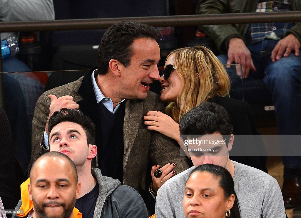 <a gi-track='captionPersonalityLinkClicked' href=/galleries/search?phrase=Olivier+Sarkozy&family=editorial&specificpeople=5577808 ng-click='$event.stopPropagation()'>Olivier Sarkozy</a> and <a gi-track='captionPersonalityLinkClicked' href=/galleries/search?phrase=Mary-Kate+Olsen&family=editorial&specificpeople=156430 ng-click='$event.stopPropagation()'>Mary-Kate Olsen</a> attend the Miami Heat vs New York Knicks game at Madison Square Garden on March 3, 2013 in New York City.