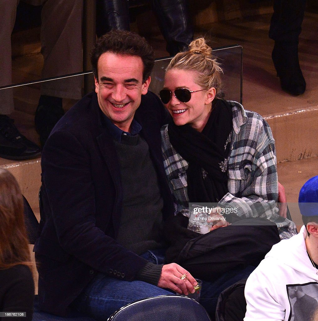 Olivier Sarkozy and Mary-Kate Olsen attend the Minnesota Timberwolves vs New York Knicks game at Madison Square Garden on November 3, 2013 in New York City.