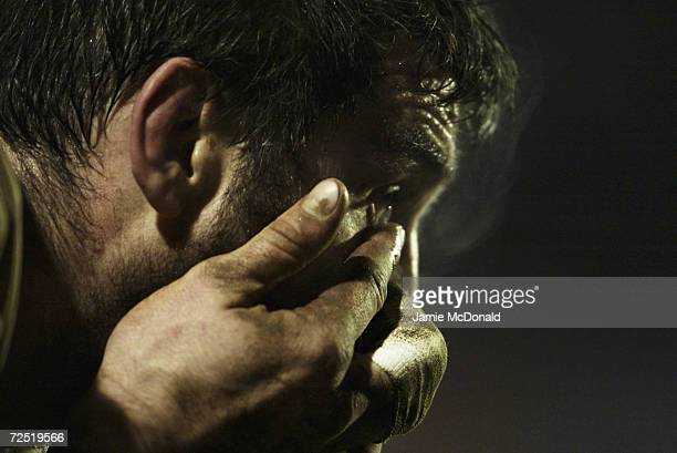 Olivier Sverzut of Agen replaces a contact lens during the Heineken Cup match between Llanelli Scarlets and Agen at Stradey Park on January 9 2004 in...