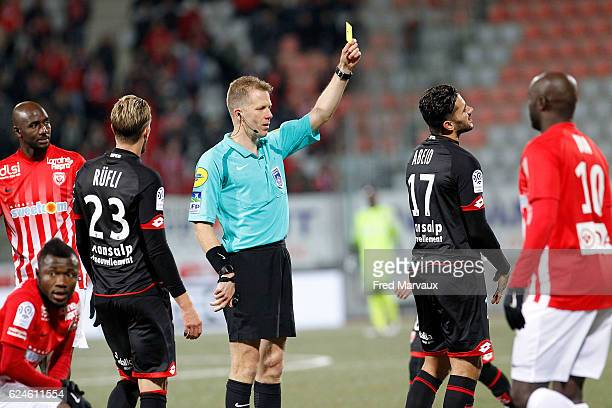 Olivier Thual referee and Mehdi Abeid of Dijon during the Ligue 1 match between As Nancy Lorraine and Dijon FCO at Stade Marcel Picot on November 19...