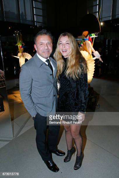 Olivier Widmaier Picasso and Arabelle ReilleMahdavi pose in front the works of JeanPaul Goude during the 'Societe des Amis du Musee d'Art Moderne du...