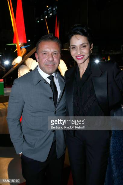 Olivier Widmaier Picasso and Farida Khelfa pose in front the works of JeanPaul Goude during the 'Societe des Amis du Musee d'Art Moderne du Centre...