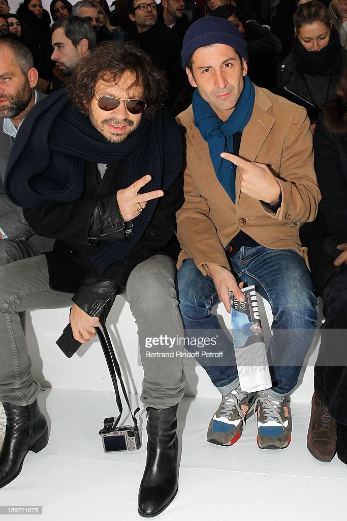 Olivier Zahn (L) and <a gi-track='captionPersonalityLinkClicked' href=/galleries/search?phrase=Andre+Saraiva&family=editorial&specificpeople=4426156 ng-click='$event.stopPropagation()'>Andre Saraiva</a>, co-owner of Paris famed night-club 'Le Baron', attend the Dior Homme Men Autumn / Winter 2013 show as part of Paris Fashion Week, at Quartier des Celestins, on January 19, 2013 in Paris, France.