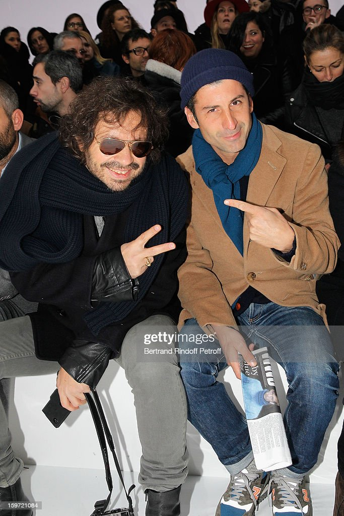 Olivier Zahn (L) and Andre Saraiva, co-owner of Paris famed night-club 'Le Baron', attend the Dior Homme Men Autumn / Winter 2013 show as part of Paris Fashion Week, at Quartier des Celestins, on January 19, 2013 in Paris, France.