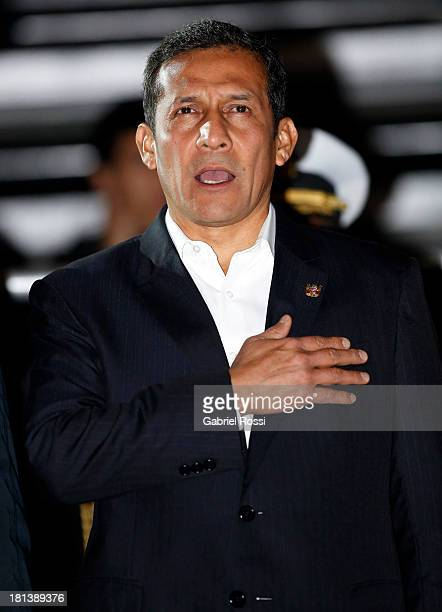 Ollanta Humala President of Peru sings the national anthem during the Opening Ceremony of the I ODESUR South American Youth Games at Plaza de Armas...