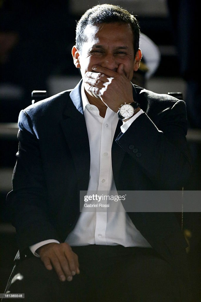 <a gi-track='captionPersonalityLinkClicked' href=/galleries/search?phrase=Ollanta+Humala&family=editorial&specificpeople=588227 ng-click='$event.stopPropagation()'>Ollanta Humala</a>, President of Peru smiles during the Opening Ceremony of the I ODESUR South American Youth Games at Plaza de Armas on September 20, 2013 in Lima, Peru