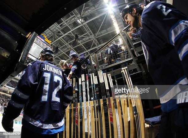 Olli Jokinen and Adam Pardy of the Winnipeg Jets head out to the ice for the start of third period action against the Nashville Predators at the MTS...