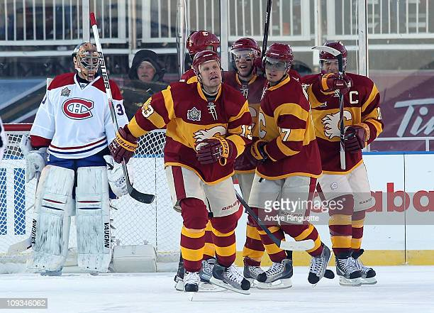 Olli Jokinen and the Calgary Flames celebrate a goal against the Montreal Canadiens during the 2011 NHL Heritage Classic Game at McMahon Stadium on...