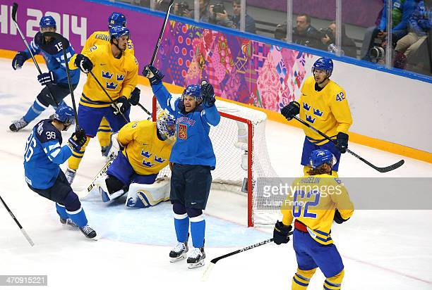Olli Jokinen of Finland celebrates after scoring in the second period against Henrik Lundqvist of Sweden during the Men's Ice Hockey Semifinal...