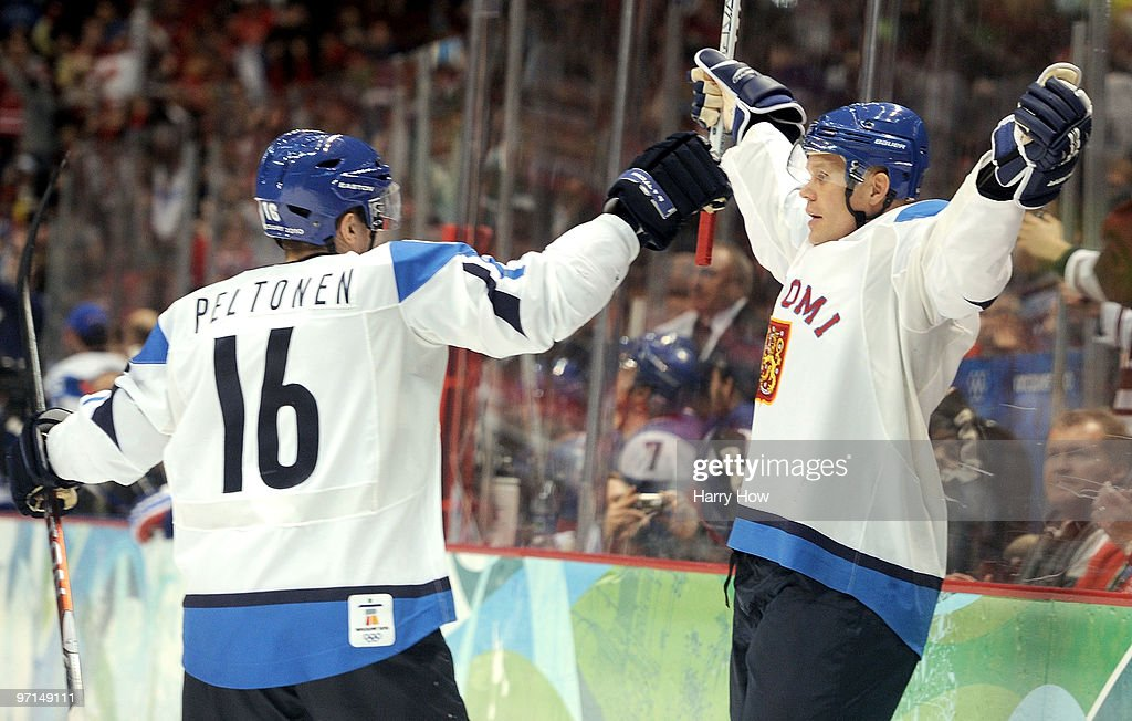 <a gi-track='captionPersonalityLinkClicked' href=/galleries/search?phrase=Olli+Jokinen&family=editorial&specificpeople=202946 ng-click='$event.stopPropagation()'>Olli Jokinen</a> #12 of Finland celebrates his goal with <a gi-track='captionPersonalityLinkClicked' href=/galleries/search?phrase=Ville+Peltonen&family=editorial&specificpeople=220547 ng-click='$event.stopPropagation()'>Ville Peltonen</a> #16 during the ice hockey men's bronze medal game between Finland and Slovakia on day 16 of the Vancouver 2010 Winter Olympics at Canada Hockey Place on February 27, 2010 in Vancouver, Canada.