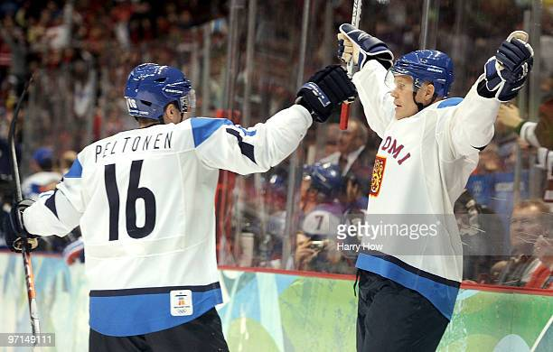 Olli Jokinen of Finland celebrates his goal with Ville Peltonen during the ice hockey men's bronze medal game between Finland and Slovakia on day 16...