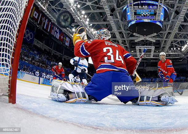 Olli Jokinen of Finland shoots and scores against Lars Volden of Norway in the second period during the Men's Ice Hockey Preliminary Round Group B...