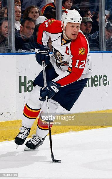 Olli Jokinen of the Florida Panthers controls the puck against the Tampa Bay Lightning at St Pete Times Forum on March 25 2008 in Tampa Florida