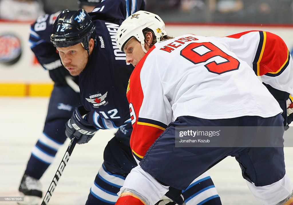 <a gi-track='captionPersonalityLinkClicked' href=/galleries/search?phrase=Olli+Jokinen&family=editorial&specificpeople=202946 ng-click='$event.stopPropagation()'>Olli Jokinen</a> #12 of the Winnipeg Jets and Stephen Weiss #9 of the Florida Panthers get set for a third period face-off at the MTS Centre on February 5, 2013 in Winnipeg, Manitoba, Canada.