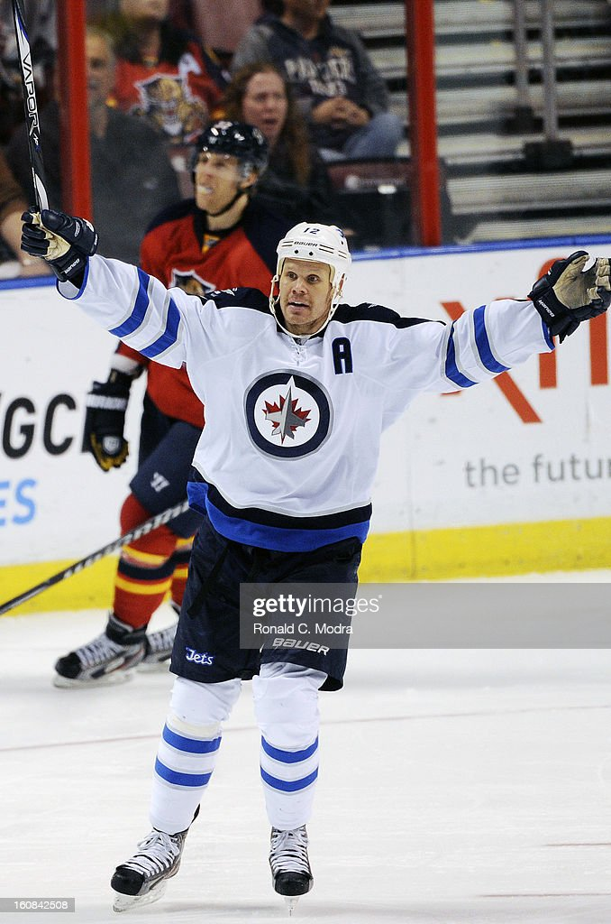 Olli Jokinen #12 of the Winnipeg Jets celebrates during a NHL game against the Florida Panthers at the BB&T Center on January 31, 2013 in Sunrise, Florida.