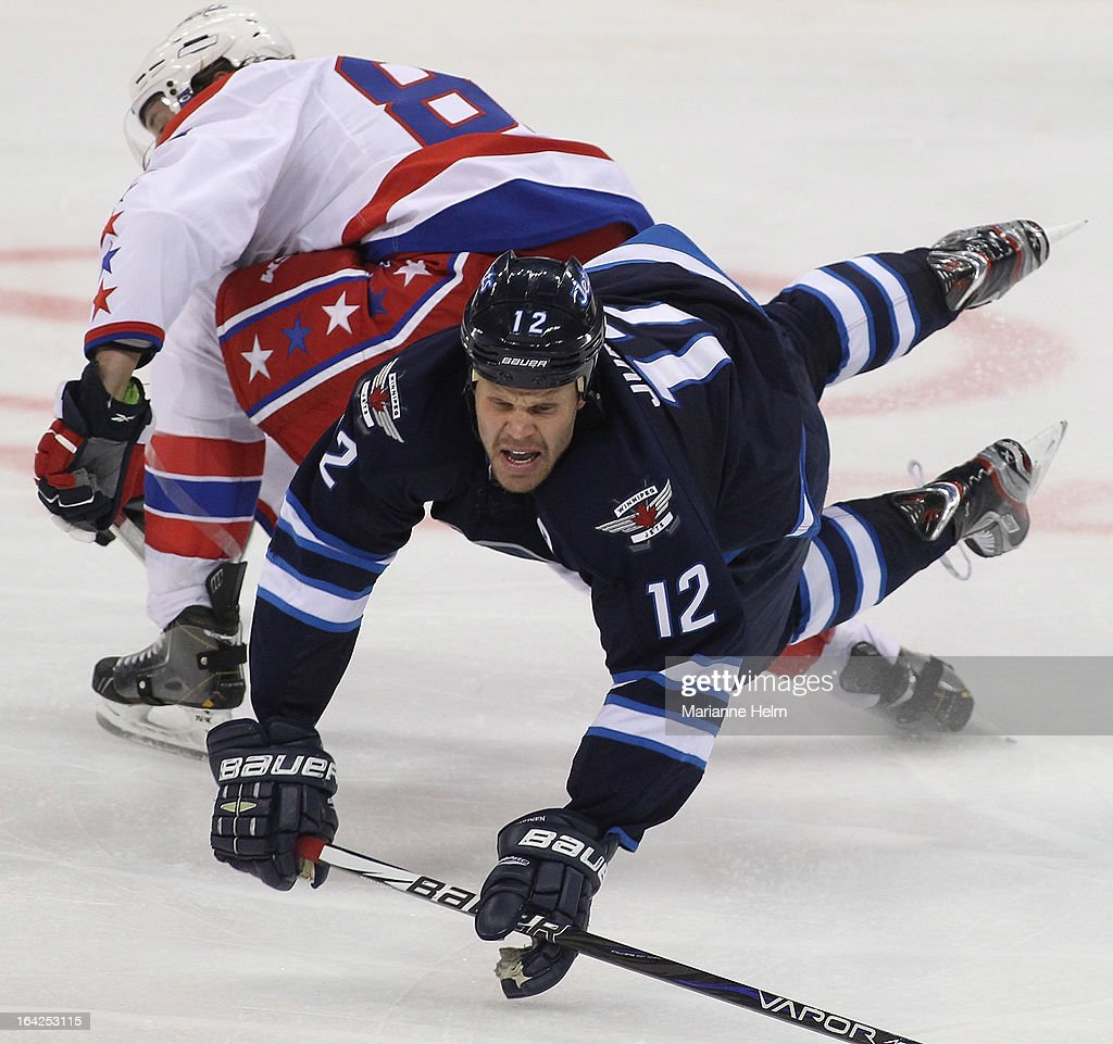 <a gi-track='captionPersonalityLinkClicked' href=/galleries/search?phrase=Olli+Jokinen&family=editorial&specificpeople=202946 ng-click='$event.stopPropagation()'>Olli Jokinen</a> #12 of the Winnipeg Jets collides with Jay Beagle #83 of the Washington Capitals during third-period action on March 21, 2013 at the MTS Centre in Winnipeg, Manitoba, Canada.