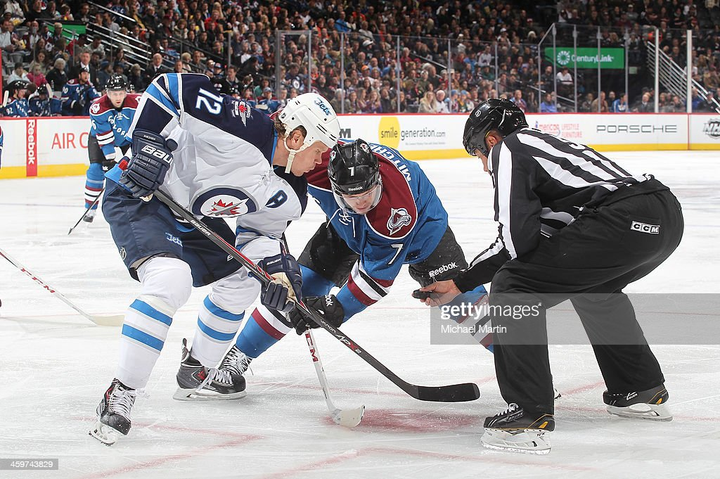 <a gi-track='captionPersonalityLinkClicked' href=/galleries/search?phrase=Olli+Jokinen&family=editorial&specificpeople=202946 ng-click='$event.stopPropagation()'>Olli Jokinen</a> #12 of the Winnipeg Jets faces off against <a gi-track='captionPersonalityLinkClicked' href=/galleries/search?phrase=Matt+Duchene&family=editorial&specificpeople=4819304 ng-click='$event.stopPropagation()'>Matt Duchene</a> #9 of the Colorado Avalanche at the Pepsi Center on December 29, 2013 in Denver, Colorado.ÊThe Jets defeated the Avalanche 2-1 in overtime.Ê