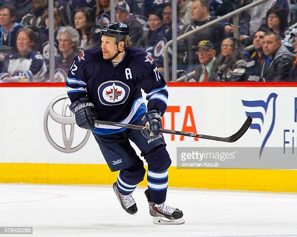 Olli Jokinen of the Winnipeg Jets follows the play up the ice during third period action against the New York Islanders at the MTS Centre on March 4...