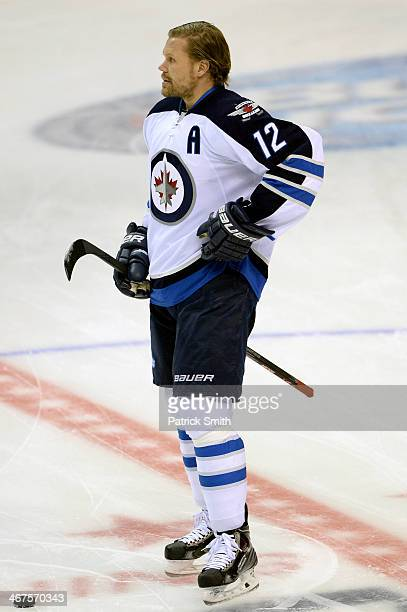 Olli Jokinen of the Winnipeg Jets in action against the Washington Capitals during an NHL game at the Verizon Center on February 6 2014 in Washington...