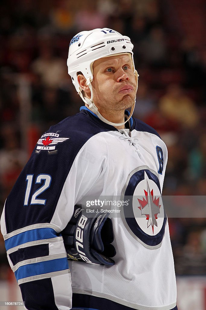 Olli Jokinen #12 of the Winnipeg Jets on the ice during a break in the action against the Florida Panthers at the BB&T Center on January 31, 2013 in Sunrise, Florida.