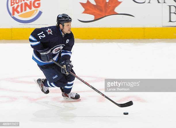Olli Jokinen of the Winnipeg Jets plays the puck up the ice during second period action against the Dallas Stars at the MTS Centre on March 16 2014...