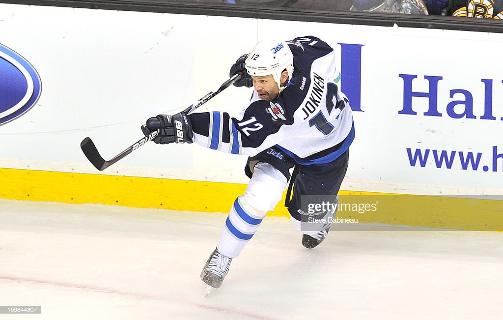 <a gi-track='captionPersonalityLinkClicked' href=/galleries/search?phrase=Olli+Jokinen&family=editorial&specificpeople=202946 ng-click='$event.stopPropagation()'>Olli Jokinen</a> #12 of the Winnipeg Jets shoots the puck against the Boston Bruins at the TD Garden on January 21, 2013 in Boston, Massachusetts.