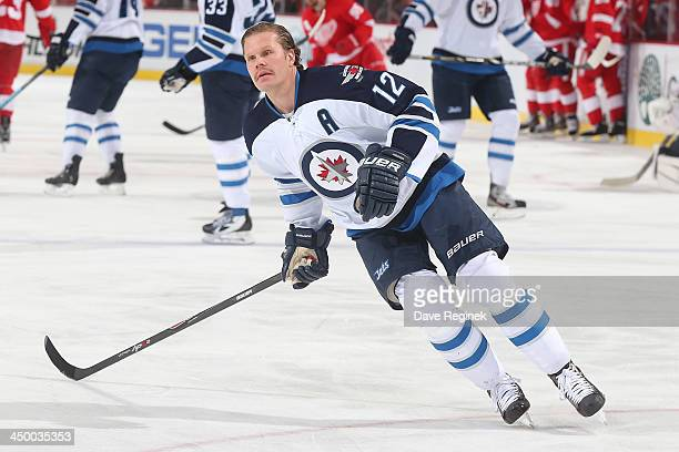 Olli Jokinen of the Winnipeg Jets shoots the puck in warmups before an NHL game against the Detroit Red Wings at Joe Louis Arena on November 12 2013...