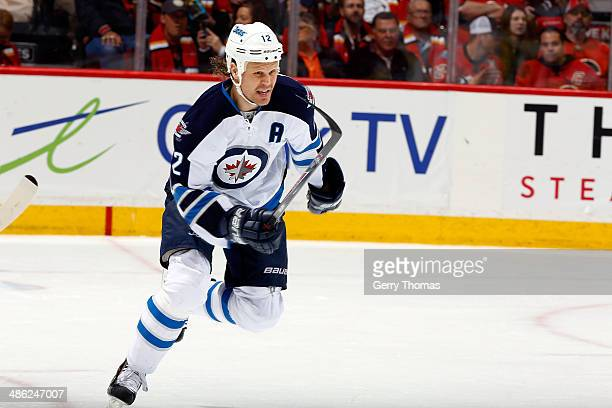 Olli Jokinen of the Winnipeg Jets skates against the Calgary Flames at Scotiabank Saddledome on April 11 2014 in Calgary Alberta Canada The Jets won...