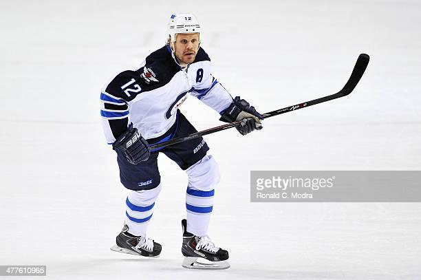 Olli Jokinen of the Winnipeg Jets skates against the Nashville Predators at Bridgestone Arena on March 1 2014 in Nashville Tennessee